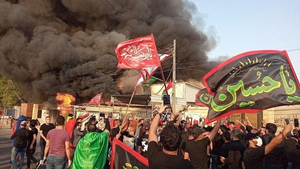 Angry protesters in Baghdad broke into the headquarters of Iraqi TV channel Dijlah and set the building on fire (photos from social media).