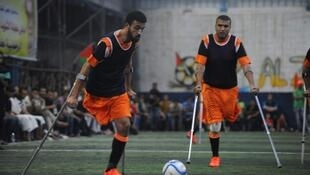 "Two players from the ""Champions Club"" in Deir el-Balah. (Photo by Gazan photographer Ashraf Amra)."