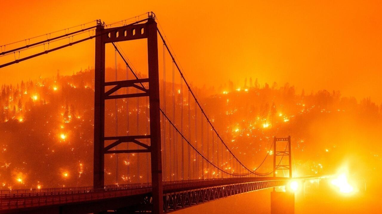 Bidwell Bar Bridge in Oroville, California, where the fires have ravaged an adjacent hill. Photo posted on Twitter.