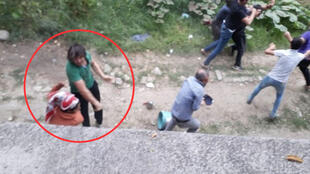 This screengrab shows a man hitting a 14-year-old Kurdish girl who, along with her family, was working as a seasonal worker gathering hazelnuts in the Sakarya region of northern Turkey.