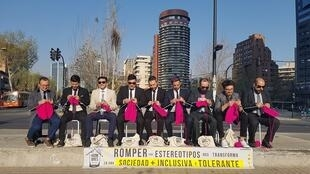 """In the business district of Santiago, the capital of Chile, the """"hombres tejedores"""" get together and knit in a unique protest for a more tolerant and inclusive society. Photo: Rodrigo Isla of the Hombres Tejedores"""