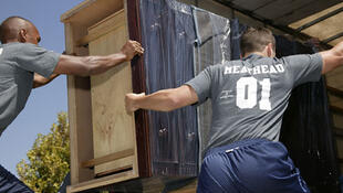 Two staffers of Meathead Movers.