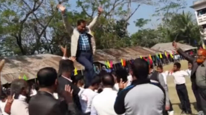A screengrab from a video of Patwary walking over the backs of students.
