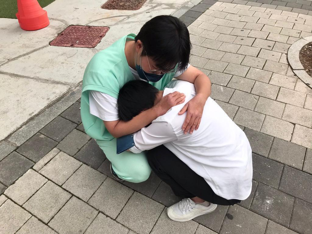 In this photo, Ju-hee, the founder of Haehil, comforts one of her members. According to the feminist group, the woman has suffered from anxiety and been on medication ever since the attack.