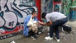 """Long-time users Brink and Joe prepare to shoot what they think is heroin in an alley in Vancouver's Downtown Eastside. Users never know how much deadly fentanyl their dealer might have mixed in. Brink says with a laugh, """"Hope I don't OD."""""""