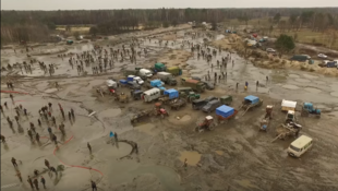 Miners dig for amber. This screenshot is from footage filmed by activists from the AutoMaidan group.