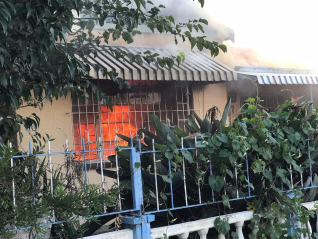 A photo of a burning house, allegedly a brothel, in Rosettenville, South Africa. Photo taken by @MichaelSun168.