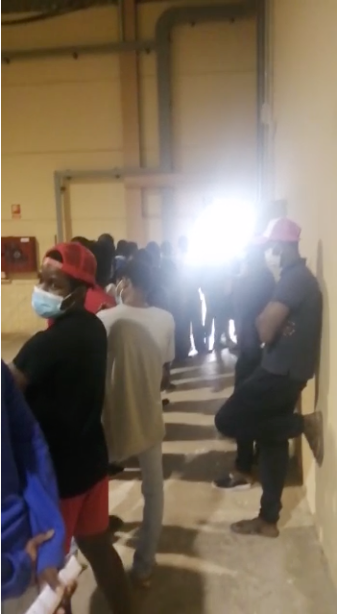 Migrants wait for a Covid-19 test at the quarantine centre in Fuerteventura on May 11, 2021.