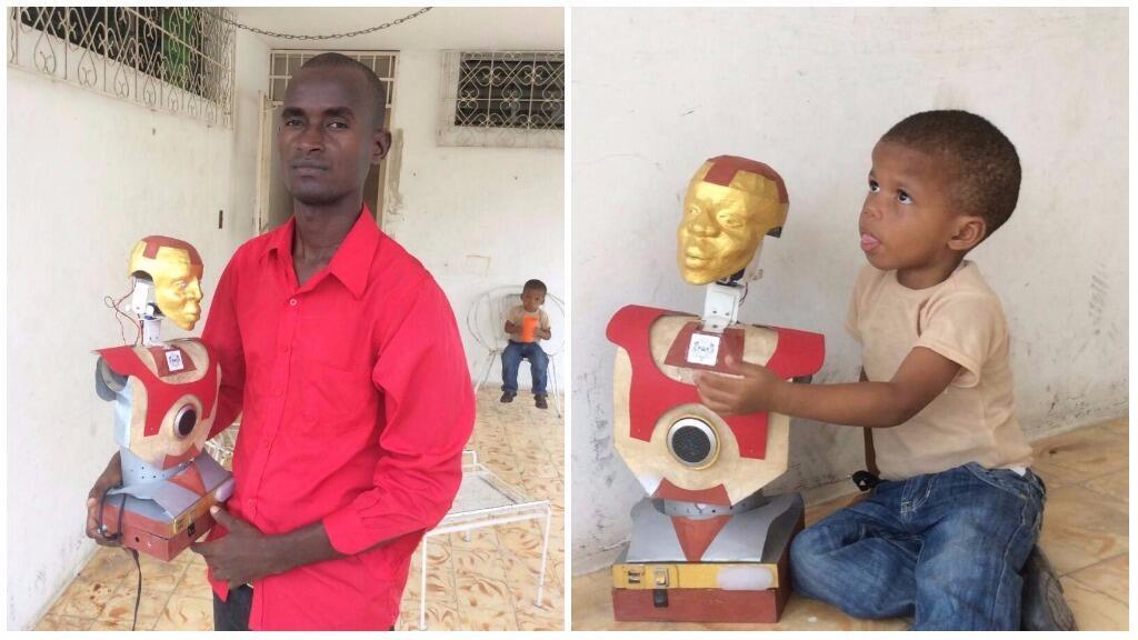 Jean-Max Dumont and his son pose with the robot Dumont made from recycled materials in Port-au-Prince.