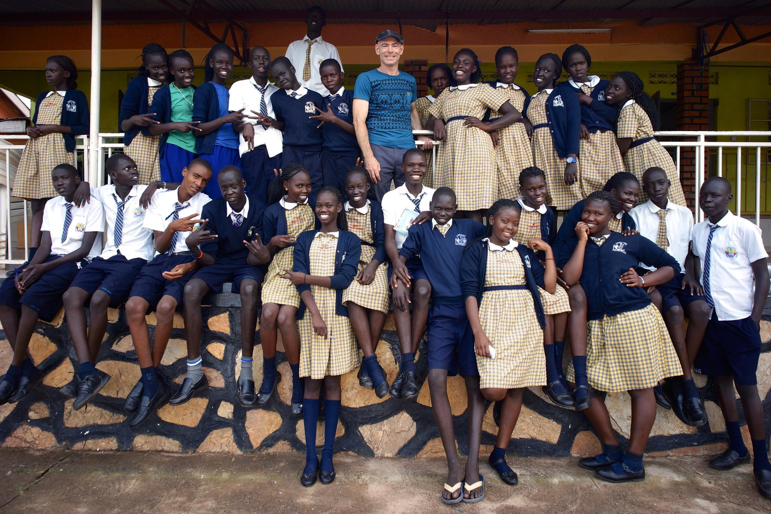 South Sudanese students at Trinity boarding school in Uganda. In the middle of the top row, the man with a hat is Rami Gudovitch, programme co-director for the Come True project, which funds the children's schooling. Photo courtesy of Rami Gudovitch.