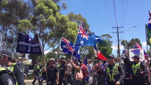 Anti-Islam protesters flew French flags alongside Australian ones at their nationwide protests Sunday. This screen grab is from a video of a rally in Melton, a suburb of Melbourne.