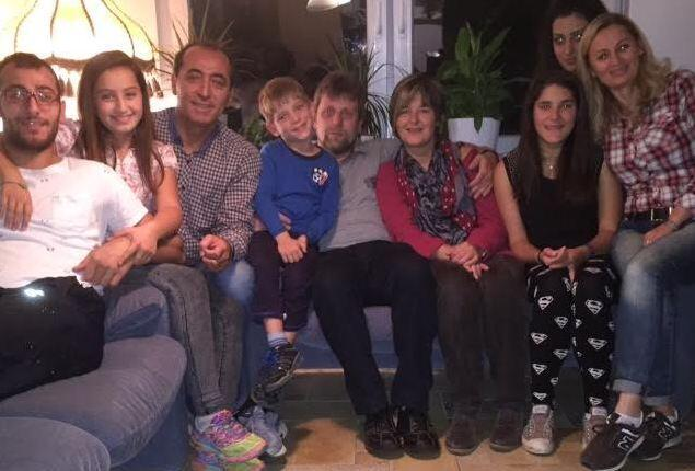 The Moos family, who live in Germany, opened up their home to the Battal family, refugees from Syria. Peryhan, from Syria, is on the far right; Petra, her new German friend, is fourth from right.
