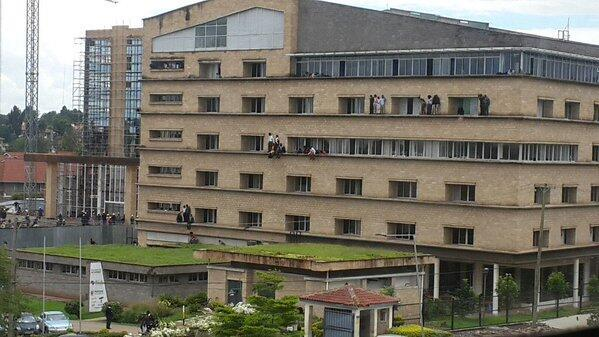Students and staff trying to flee Strathmore University by climbing out the windows.