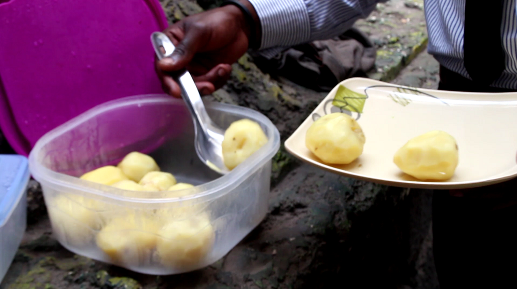 Franck Bulonza serves lunch to his customers in Goma, DRC.
