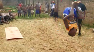 In a video taken on May 30, Yiga Mustafa's group practices doing flips in a vacant lot. Video provided to the Observers.