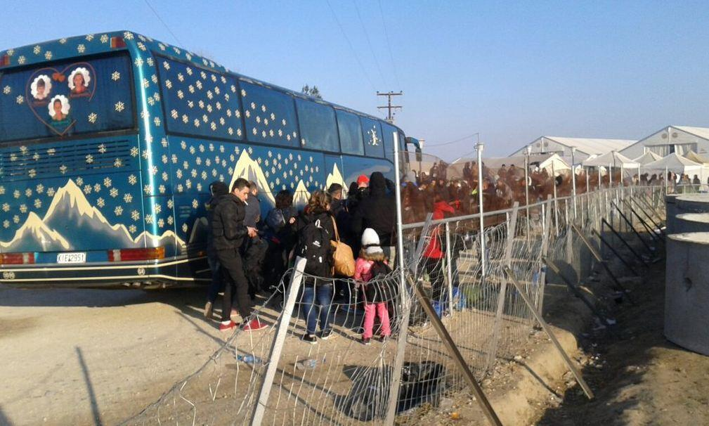 Greek police forcing migrant families to board buses to take them from the Macedonian border to Athens. Photo courtesy of Tracy @pixiecottage.
