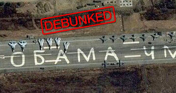 """Russian airplanes on the runway of Latakia airport in Syria. The insult """"Obama is an idiot"""" was added to the photo."""