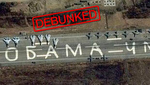 "Russian airplanes on the runway of Latakia airport in Syria. The insult ""Obama is an idiot"" was added to the photo."