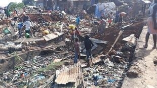 Dans le quartier de Dabondy, à Conakry, le lendemain de l'inondation