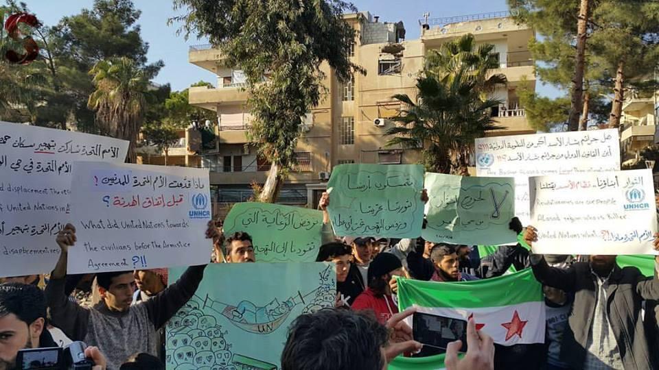 Protest against the evacuation of residents of Hom's last rebel-held neighbourhood.