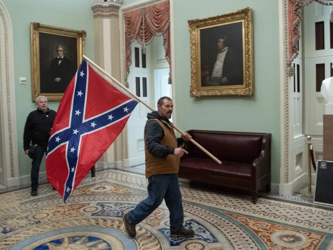 A man brandishes the Confederate flag in the Capitol on January 6, 2021.