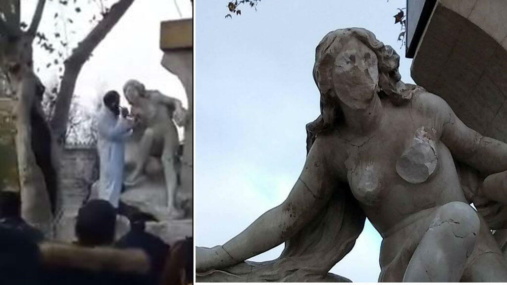 A man hacks at the naked breast of this statue in Sétif, on the 18th December 2017.