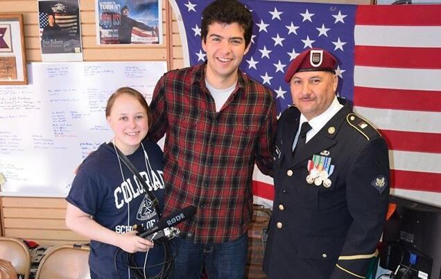 Hector Barajas with students, inside the Deported Veterans Support House.