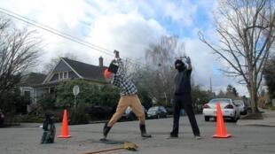 Members of PARC fix a pothole in Portland.