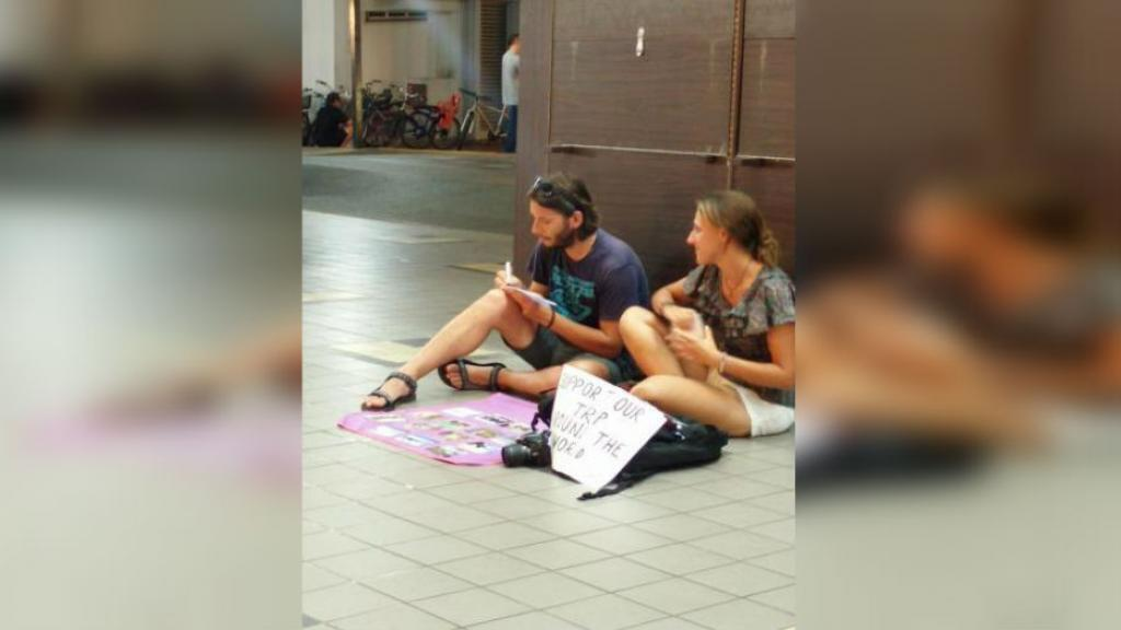 Backpackers sell postcards in order to fund their travels.