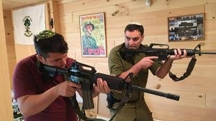 Director and founder of Cherev Gidon Israeli Tactical Training Academy, Yonatan Stern (r), training with another gun user.