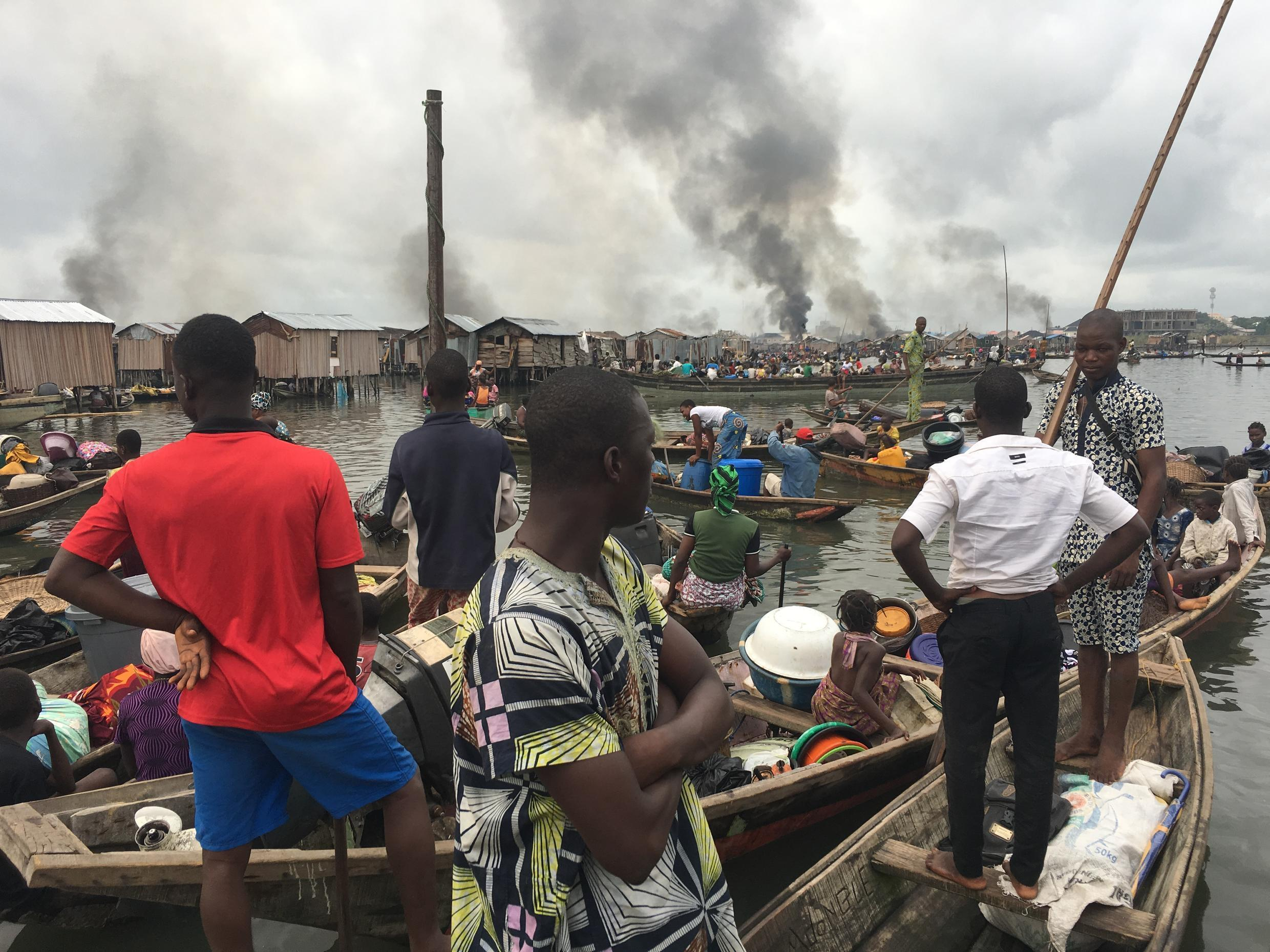 Residents of Otodo Gbamé watch as their homes burn. Photo: Justice and Empowerment Initiatives