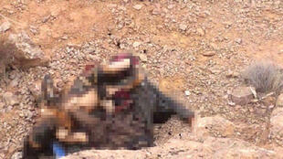 The burnt bodies of Soraya and her cousin. Photo posted to Facebook by local activists. (Photo blurred by France 24).