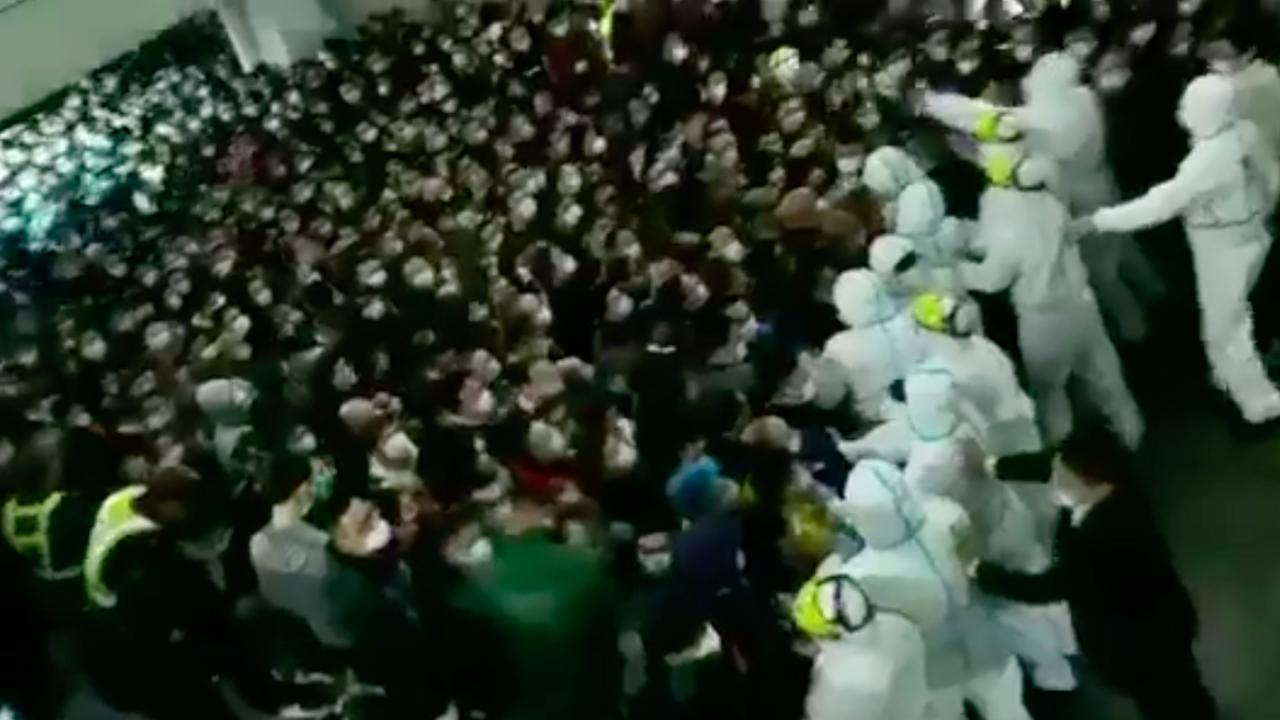 Chaos breaks out in Shanghai airport as authorities try to hold workers there for Covid-19 testing